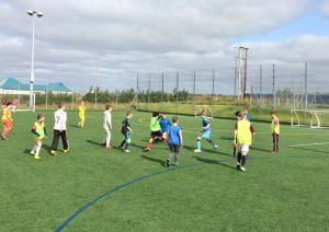 P4 – 7 children taking part in a small-sided game.
